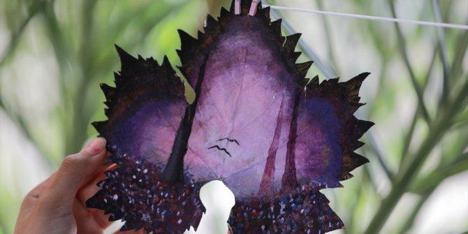 Filistinli genç kız asma yapraklrından sanat harikaları yaratıyor