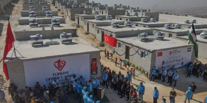 Hayırseverlerin desteğiyle İdlib'de yapılan 600 konut ailelere teslim edildi