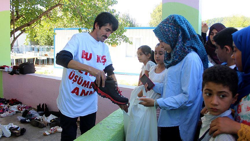 'Simitçi Erkan' Suriyeli yetimleri sevindirdi