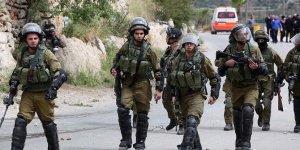 İsrail askerlerinden 15 Filistinliye gözaltı!