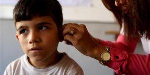 İHH'den Suriyeli çocuklara işitme cihazı