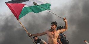 İsrail sembol fotoğraftaki Filistinli genci hedef aldı